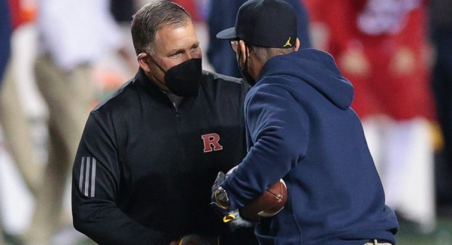 Nov 21, 2020; Piscataway, New Jersey, USA; Rutgers Scarlet Knights head coach Greg Schiano, left, shakes hands with Michigan Wolverines head coach Jim Harbaugh before their game at SHI Stadium. Mandatory Credit: Vincent Carchietta-USA TODAY Sports