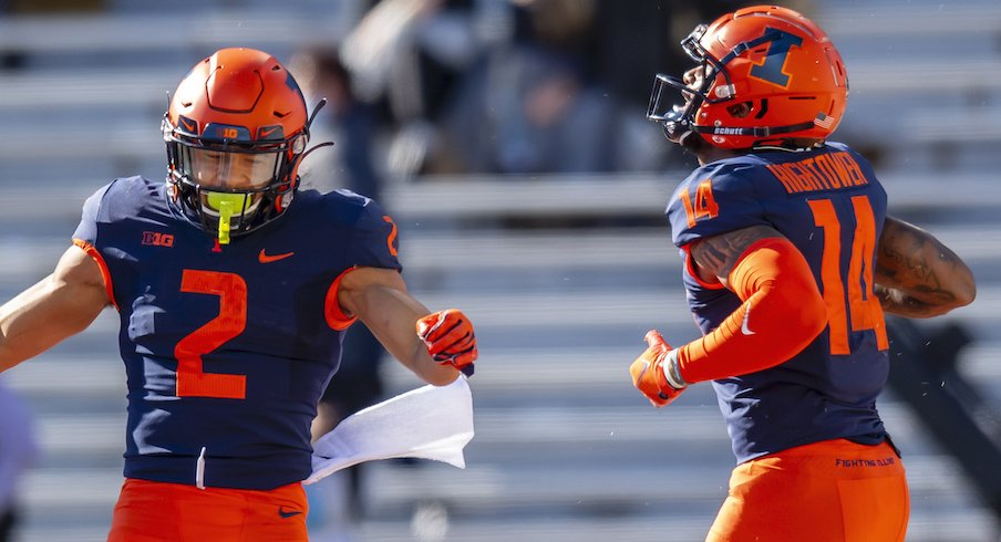 Illinois' Chase Brown and Brian Hightower