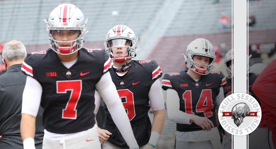 Ohio State quarterbacks walk on the field.