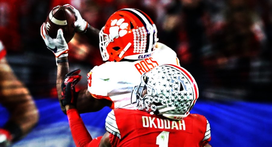 Dec 28, 2019; Glendale, Arizona, USA; Ohio State Buckeyes cornerback Jeff Okudah (1) breaks up a pass against Clemson Tigers Justyn Ross (8) in the third quarter in the 2019 Fiesta Bowl college football playoff semifinal game. The play was reviewed and not ruled a fumble. Mandatory Credit: Matthew Emmons-USA TODAY Sports