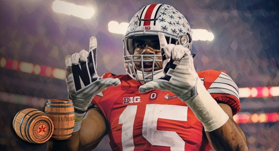 Ohio State Buckeyes running back Ezekiel Elliott (15) celebrates scoring a touchdown on a 33-yard run during the first quarter of the College Football Playoff National Championship against the Oregon Ducks at AT&T Stadium in Arlington, Texas on Jan. 12, 2015.